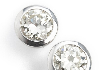 A pair of diamond ear studs each set with an old-cut diamond weighing a total of app. 4.00 ct., mounted in 18k white gold. (2)