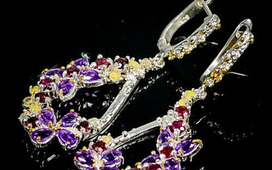 A pair of ear pendants each set with numerous circular-cut and pear shaped amethysts, opals and rhodolite garnets, mounted in rhodium plated sterling silver.