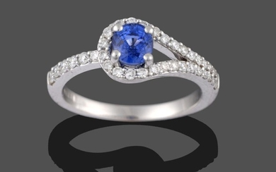 An 18 Carat White Gold Sapphire and Diamond Ring, the...