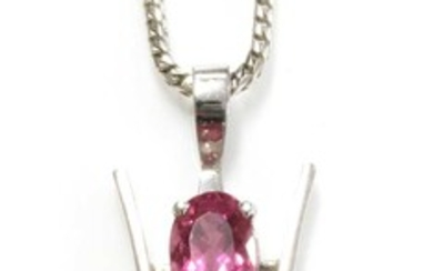 An 18ct white gold three stone pink tourmaline pendant