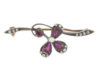 An early 20th century silver and gold, ruby and imitation pearl floral brooch, with diamond accents.