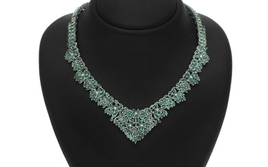 An emerald necklace set with numerous navette and circular-cut emeralds, mounted in rhodium plated sterling silver. L. app. 40.5 cm.