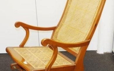 Antique teak rocking chair with caned seat and back, 53cm wi...