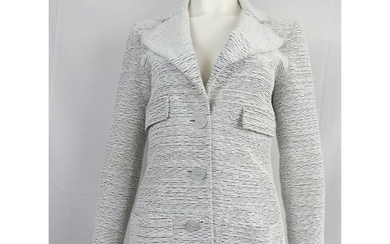 CHANEL. Ivory and silver velvet tweed jacket. Buttons...