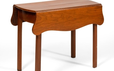 "CHIPPENDALE PEMBROKE TABLE In cherry, with shaped drop leaves and block linenfold legs. Height 27.75"". Length 19"" plus two 9"" drop l..."