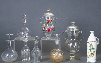 Enameled porcelain carafe with hand-painted flower decoration. With...