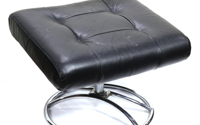 Modern black leather and chrome lounge chair with ottoman