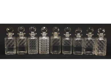 Nine 19th century cut glass decanters with stoppers, each ap...