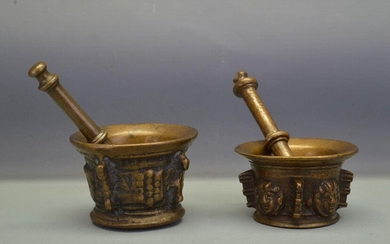 Pair of bronze mortars and pestle with brown...