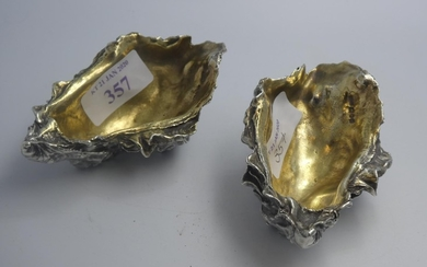 Pair of modern designer cast silver crustacean salts with gi...