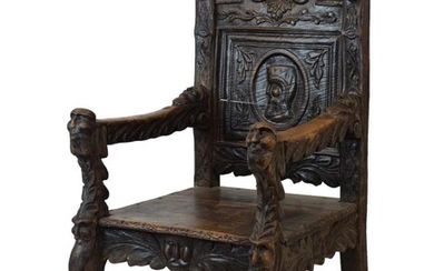 Renaissance Revival carved elm throne chair, the back headed...