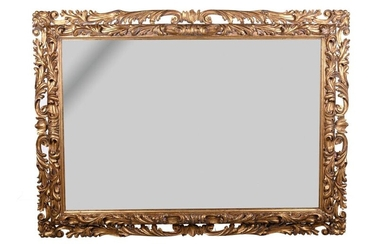mirror Italian manufacture, early 20th centuryin gilt-wood and richly carved with scrolls and leaves 134 x 18 1 cm
