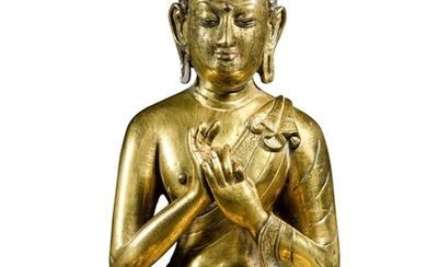 A GILT COPPER-ALLOY FIGURE OF A DHARMACHAKRA BUDDHA TIBET OR NEPAL, 18TH/19TH CENTURY | 十八/十九世紀 尼泊爾或西藏 鎏金銅佛坐像