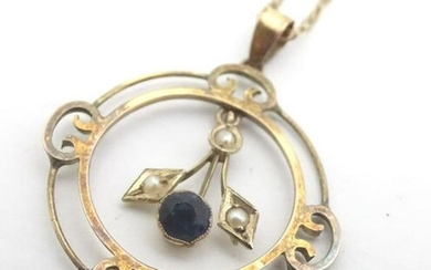 A 9ct gold pendant and chain, the pendant set with blue