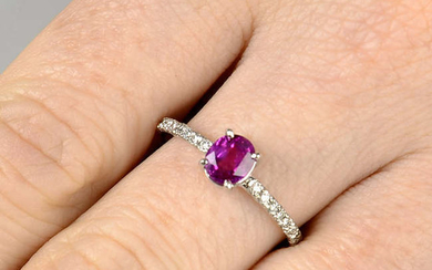 A Burmese pink sapphire single-stone ring, with brilliant-cut diamond line sides.