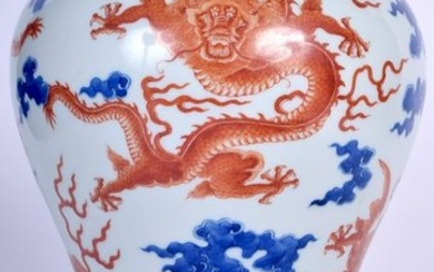 A CHINESE BLUE AND WHITE BALUSTER VASE bearing Qianlong