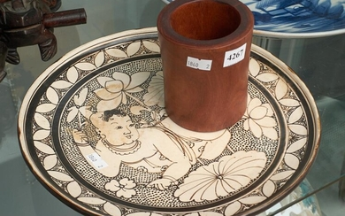 A CHINESE PAINTED POTTERY DISH AND A CARVED BRUSH POT