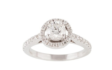 A DIAMOND CLUSTER RING, the brilliant cut diamond to diamond...