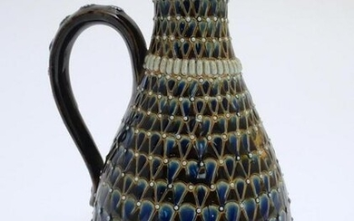 A Doulton Lambeth stoneware jug / ewer with relief