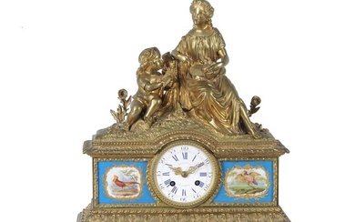 A French gilt metal and Sevres style porcelain mounted mantel clock