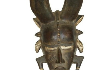 A HAND-PAINTED WOODEN MASK. COTE D'IVOIRE, 20TH C.