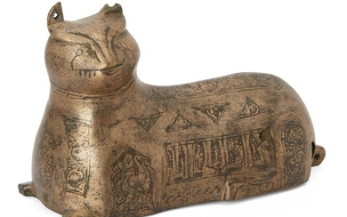 A Khorasan bronze weight in the form of a lion,...