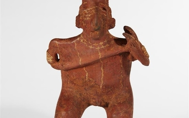 A Nayarit pottery figure of a standing male musician...