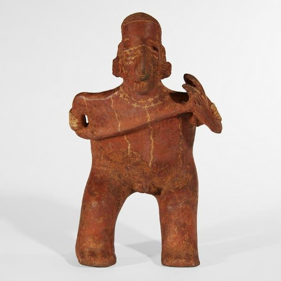 A Nayarit pottery figure of a standing male musician