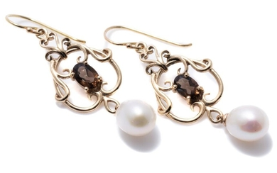 A PAIR OF NOUVEAU STYLE GEMSET EARRINGS; 9ct gold scrolling frames 14.7mm wide each centring an oval cut smoky quartz suspending a 7...