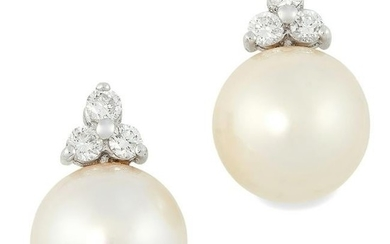 A PAIR OF PEARL AND DIAMOND EARRINGS each set with of a