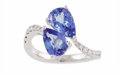A TWO STONE TANZANITE RING, of cross over design, the pear s...