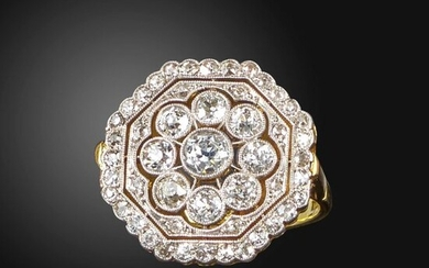 A diamond cluster ring, the octagonal-shaped plaque with pierced decoration, millegrain-set with graduated old circular-cut diamonds in platinum and gold, 18ct London hallmarks for 1996, size M 1/2