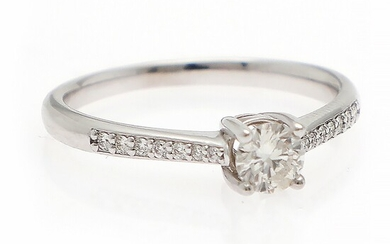 A diamond ring set with a brilliant-cut diamond weighing app. 0.40 ct. flanked by numerous diamonds, mounted in 14k white gold. Size 54.