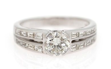 NOT SOLD. A diamond ring set with an emerald-cut diamond weighing app. 0.80 ct. flanked...