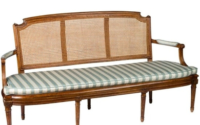 A fine French carved Louis XVI walnut settee, circa 1790