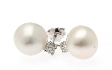 A pair of ear studs each set with a cultured freshwater pearl and a brilliant-cut diamond weighing a total of app. 0.50 ct., mounted in 14k white gold. (2)