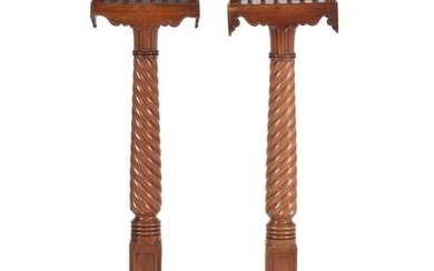 A pair of mahogany and brass strung torchere stands