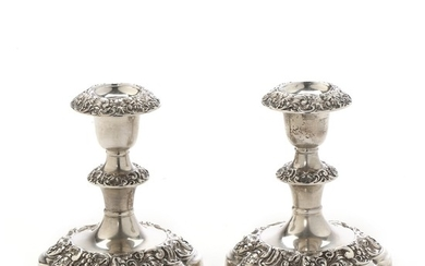 A pair of silver candlestick cast with gapes and leafes. Stamped Birmingham 1936 and mark for Elkington & Co. Filled. H. 12 cm.