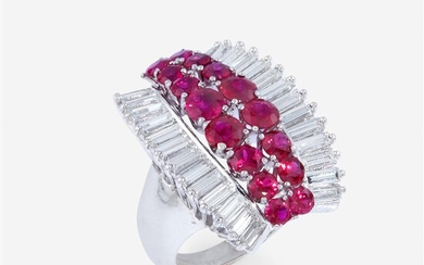 A ruby, diamond, and eighteen karat gold ring centering...