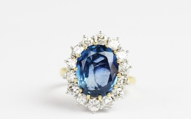 A sapphire and diamond cluster ring, the central untested ov...