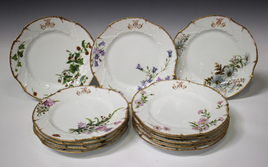 A set of twelve Limoges plates, early 20th century, painted with different flowers and insects below