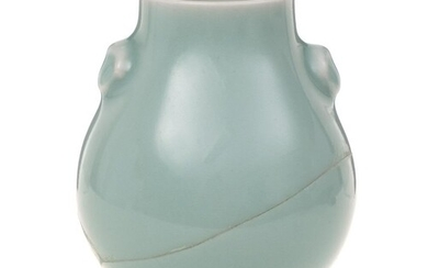 A small Chinese celadon vase: of pear shape with mask head h...