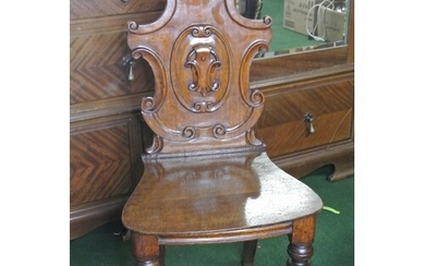 A stunning antique/ Victorian carved shield back hall chair.
