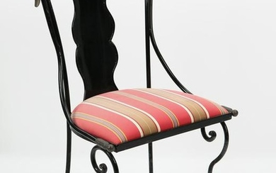 A wrought iron side chair with swan head finials