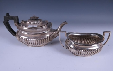 An Edward VII silver Teapot and Sugar Bowl of...