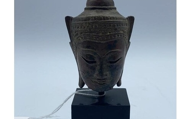 An early Buddhist bust in bronze on a marble base early 18th...