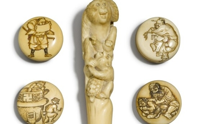 An ivory cane handle and four manju, Meiji period, late 19th century