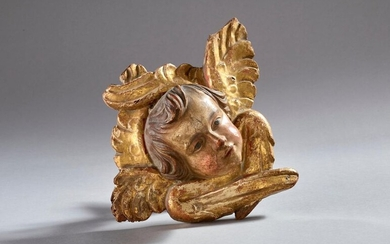 Angel in patinated and gilded wood.