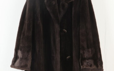 DARK BROWN SHEARED FUR STROLLER COAT WITH CUFFED SLEEVES. No...