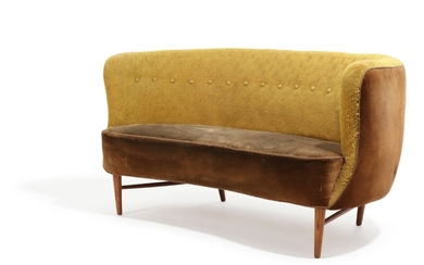 Danish furniture design: A 1940–50s banana shaped sofa, upholstered with velvet and yellowish fabric, patinated oak legs. L. 146 cm.